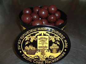 painted tin of chocolate macadamia nuts